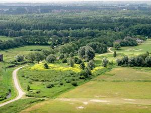 De eendenkooi vanuit een windmolen; daarachter de Amsterdamse Golfclub